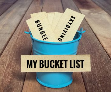 Inspirational and conceptual - 'My bucket list ' written on a white sticky paper. With vintage styled background.